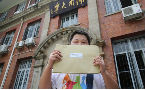 China state media acknowledges gay youth who challenged govt