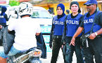 Malaysian religious police raid hotel, arrest two women for sharing room