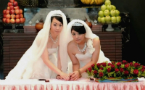 Same-sex and opposite-sex couples hold joint wedding to support equality in Taiwan.