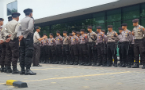 Indonesian police officer going to court, alleging he was fired for being gay